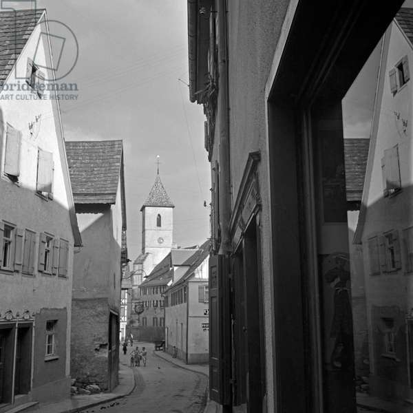 View through a lane in direction to Roman Catholic church of Our Lady at Horb at river Neckar, Germany 1930s (b/w photo)
