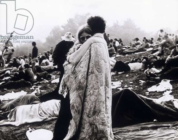 """Couple embracing at Woodstock, 1969, still from the documentary """"Woodstock"""" by Michael Wadleigh, 1970 (b/w photo)"""