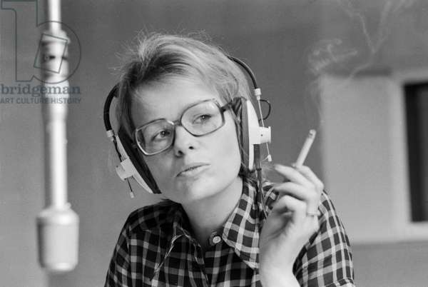 German journalist and author Wibke Bruhns smoking a cigarette at a radio studio, end 1960s
