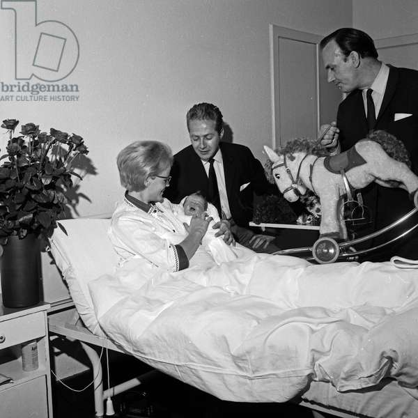 German actor Werner Bruhns visiting his wife Wibke after she gave birth to to daughter Annika, Germany 1960s