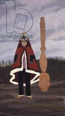 Haisla Dancer and Chilakoous Totem Pole.  Gitamaat Village, B.C. Canada