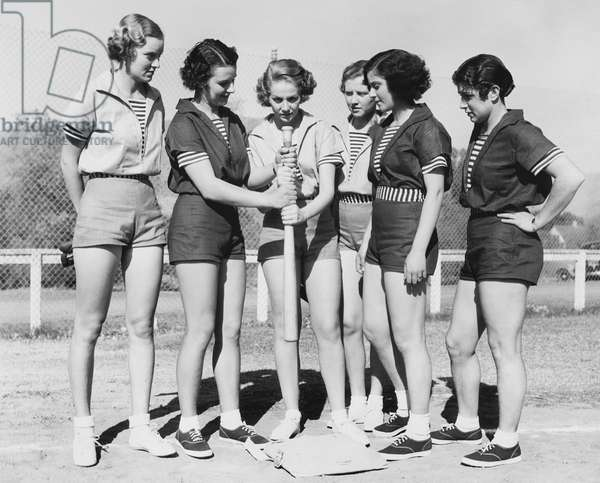 Woman Holding a Baseball Bat and Giving Training to Other Women