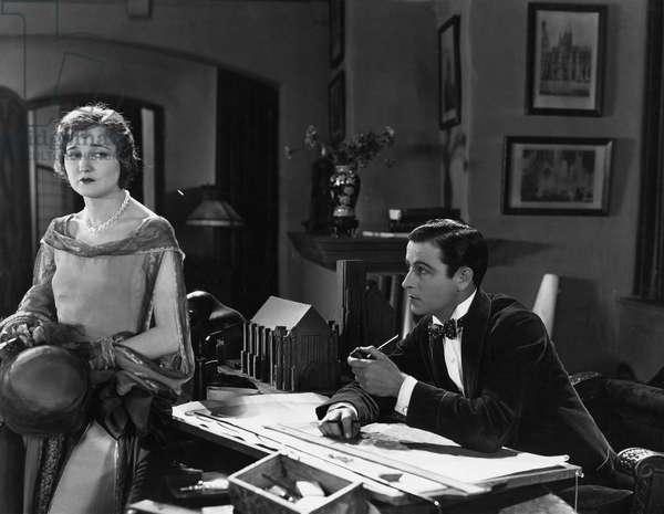 Man at Desk and Upset Woman