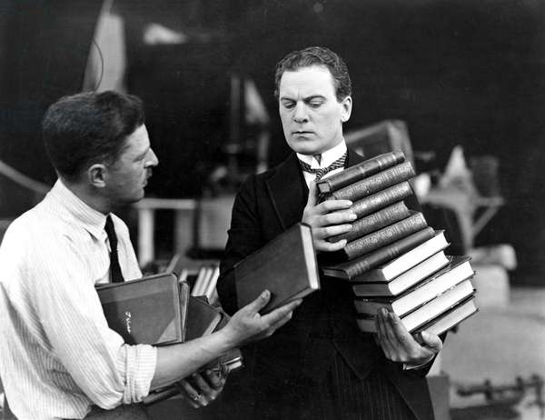 Men with Stacks of Books