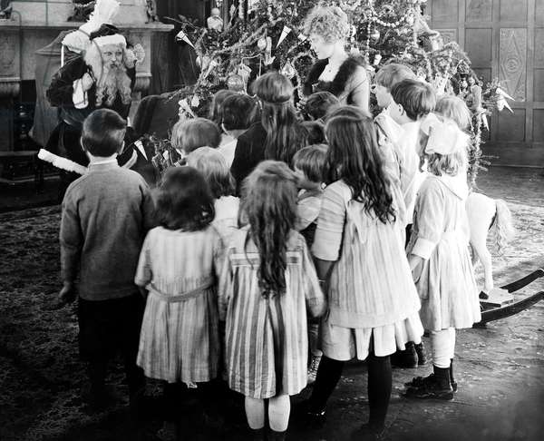 Santa Claus Visiting with Large Group of Children