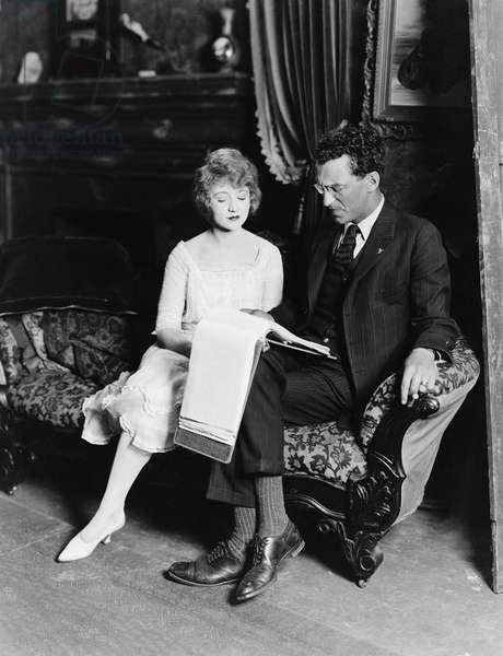 Man and Woman on Couch with Paperwork
