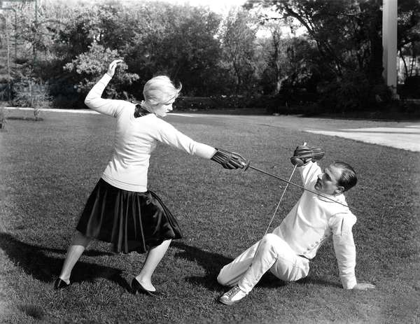 Man and Woman Fencing Outdoors