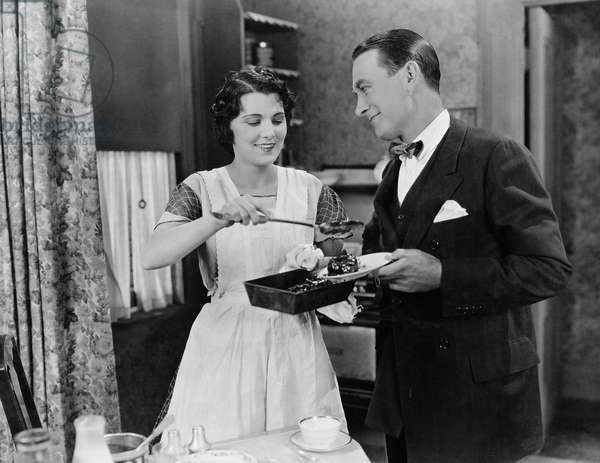 Woman Serving Food to Man