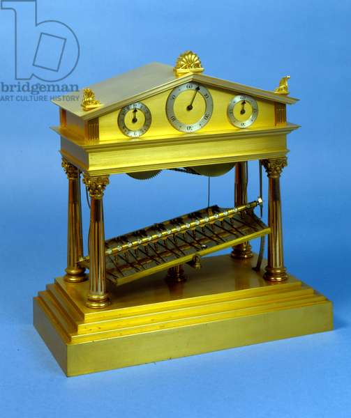 Rolling-ball clock, escapement operated by a ball rolling down a zig-zag path cut in a plate pivoted at its centre, housed in a brass cover in the form of a Greek Temple, holding three dials in the pediment, English, by E. Dent & Co, c.1920