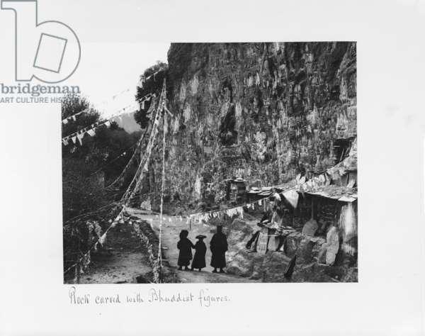 Rock carved with Buddhist figures, Tibet, 1903-04 (platinum print)