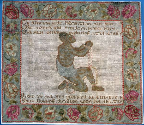 Seat cover depicting a slave in chains and an anti-slavery slogan (tapestry)