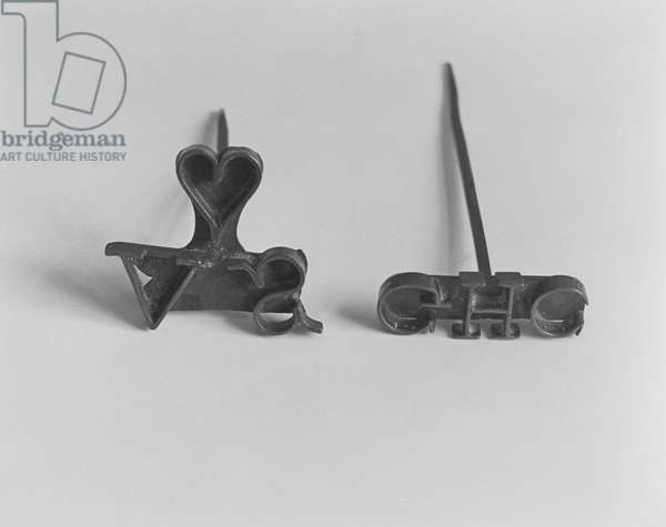 Branding irons with owners' initials (iron)