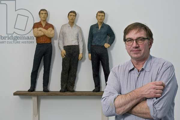 The artist with his work 'Group of Three', 1985 (mixed media)
