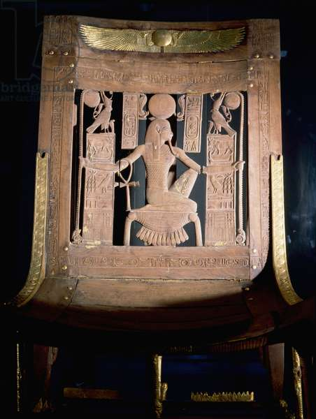 Chair with finely carved wooden surface picked out with gold foil from the tomb of Tutankhamun
