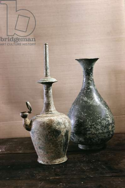 A carafe, and a ritual water vessel of unglazed, high-fired, dark grey stoneware