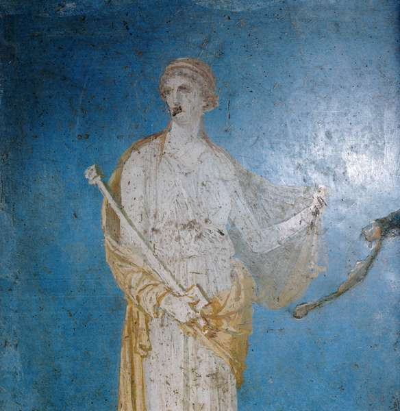 Fresco of a woman standing against a blue background