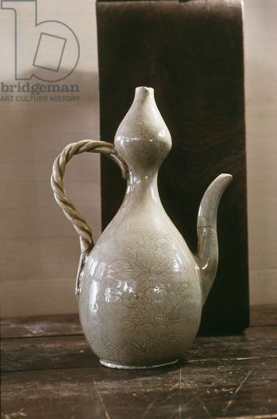 A wine ewer in a double gourd shape with a white glaze, decorated with a large flower, possibly a lotus
