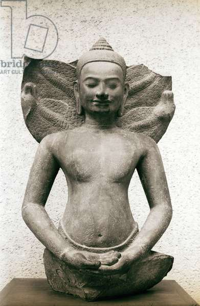 Bust of Buddha in meditation with a serpent's hood behind him