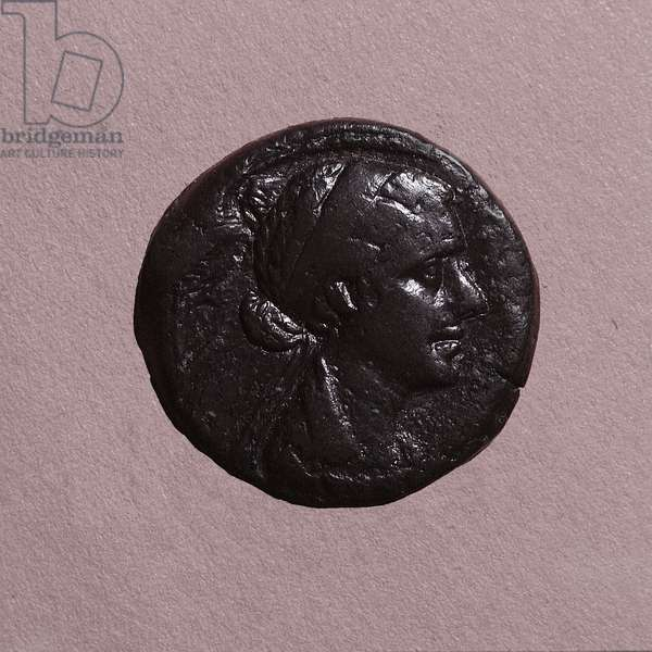 A coin with the head of Cleopatra, minted in Alexandria (alloy)