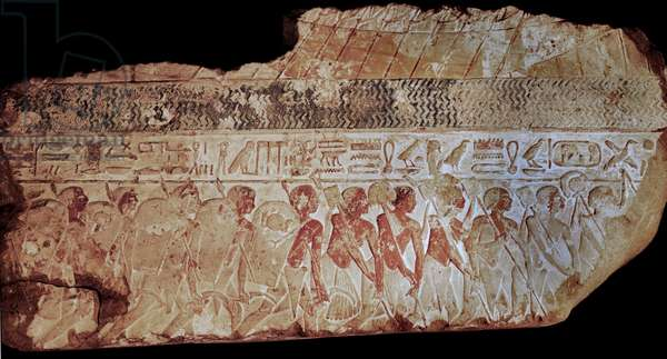 Block from a painted relief showing a parade of soldiers carrying shields,lances and sickles
