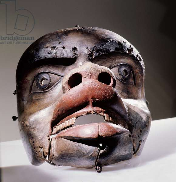 Mask depicting either a grizzly bear or a land otter