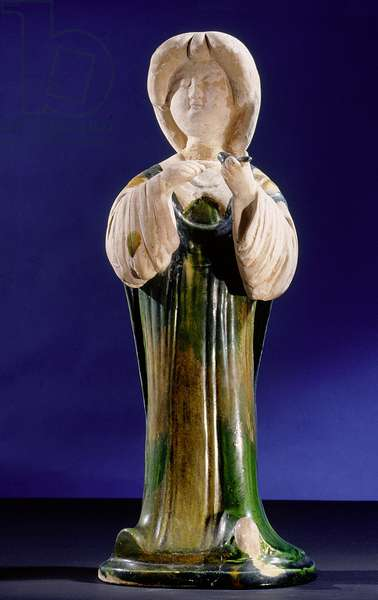 Pottery figure of a court lady holding a bird