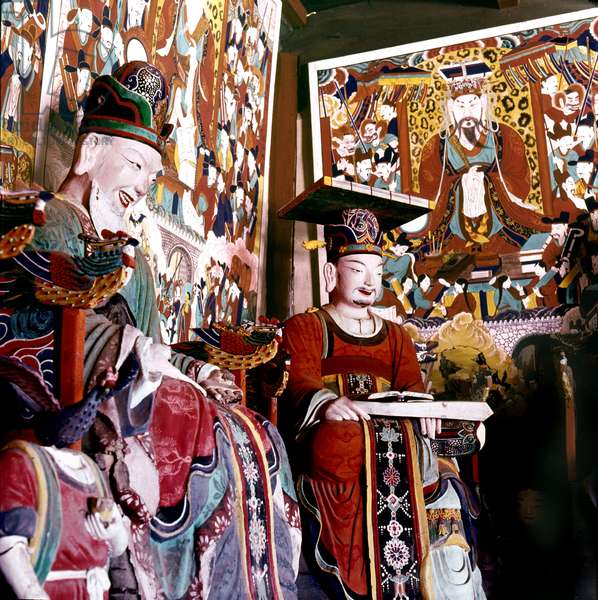 Thankas and statues of Taoist sages or monks inside the temple on Diamond Mountain