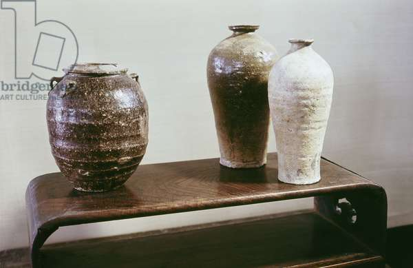 Two vases and container with a lid