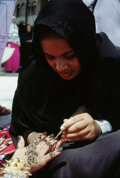 Geometric and floral decorative henna patterns were applied to adorn the hands and feet of young women on occasions such as weddings