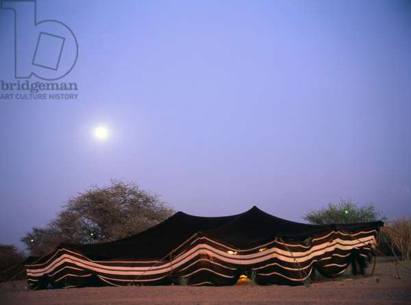 A Bedouin tent at night