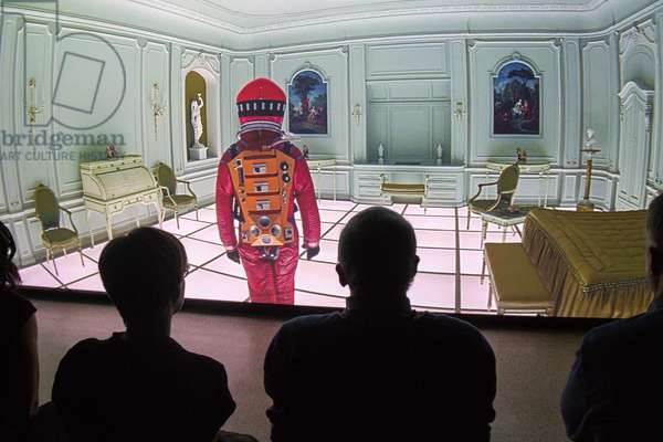 Visitors viewing a clip of, 2001: A Space Odyssey, shown at, Stanley Kubrick: The Exhibition, at the Design Museum, Kensington, London until 17 September 2019