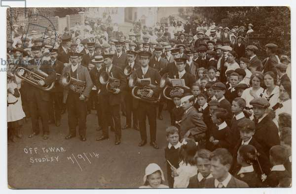 Brass band and large group of followers at the outbreak of the first World War. Studley. September 7th 1914. [The child in the Eton collar in the centre of the photograph was John Thompson who later became a local brewer]