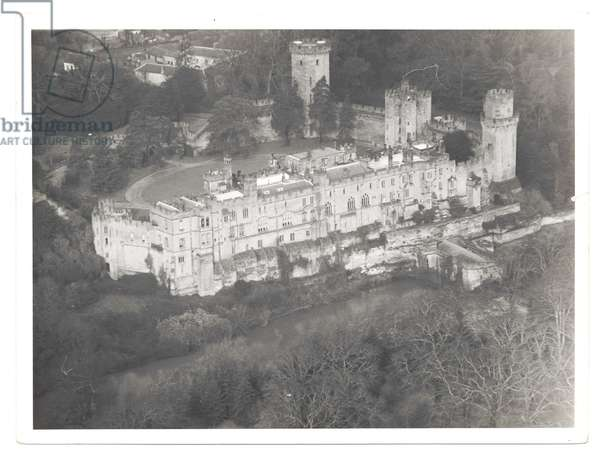 Warwick Castle from the air from the south west looking across the River Avon, 1950s (b/w photo)