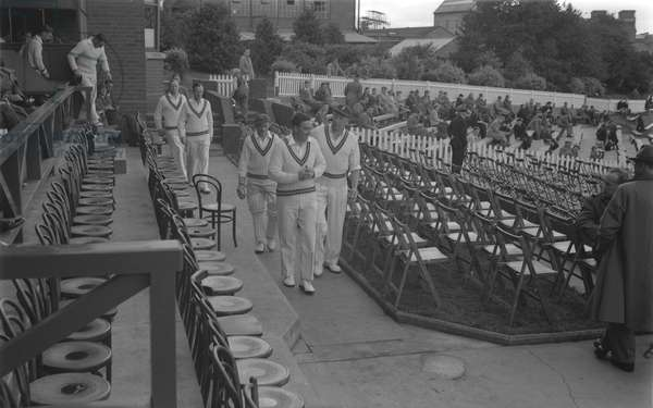 County Cricket, Warwickshire versus Nottinghamshire at the Courtaulds Ground, Lockhurst Lane, Coventry. W. Sime (Notts captain) leads out his team. Thursday 17 August 1950.