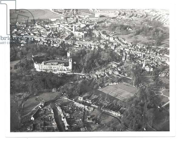 An aerial view of Warwick from the south, showing Warwick Castle, St Mary's Church and St. Nicholas Church, 1950s (b/w photo)