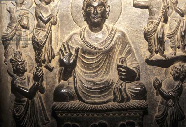 Detail of a relief depicting a seated Buddha, Gandhara (bronze)