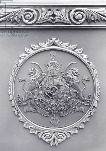 Coat of arms decorating the door of a coach belonging to the Pahlavi ruler Riza Shah, Shah of Iran (1877-1944) (b/w photo)