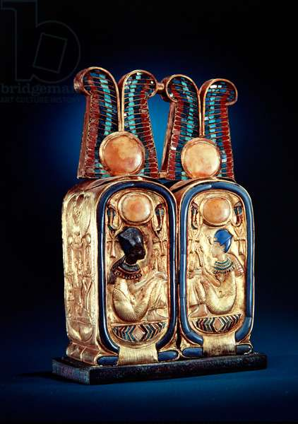 Unguent box in the form of a double royal cartouche, from the tomb of Tutankhamun, New Kingdom (gold plated wood inlaid with glass paste)