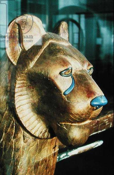 Funerary bedhead in the form of a lion, from the Tomb of Tutankhamun (c.1370-1352 BC) New Kingdom (stuccoed & gilded wood)