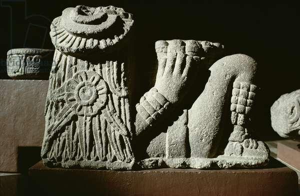 Recumbent sun god with a sun calendar disk in hair (stone)