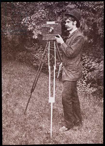 Self portrait with camera, tripod and pistol, 1886 (lantern slide)
