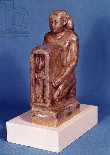 Pedesi holding a naos of Osiris (stone)