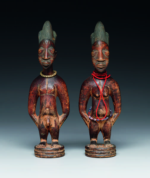 Standing male figure (ere ibeji), 20th century (wood, camwood powder, indigo, glass beads & fibre)