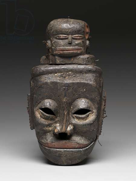 """Idiok ekpo,"" evil spirit face mask, mid-20th century (wood, encrustation, nails, paint & raffia)"