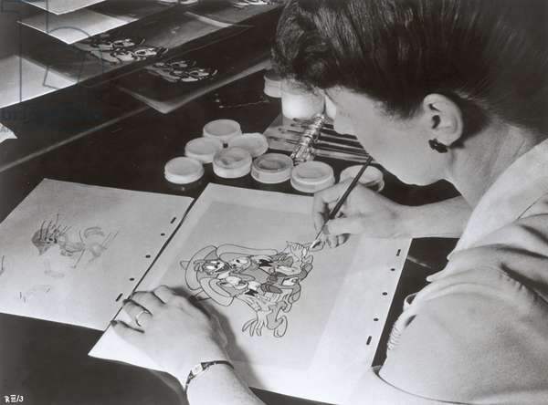 An animator from Disney Studios drawing a still for