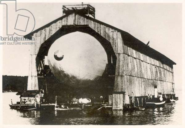 The prototype airship Zeppelin LZ1 in floating hangar in the Bay of Manzell, Lake Constance, Friedrichshafen, 1900 (b/w photo)