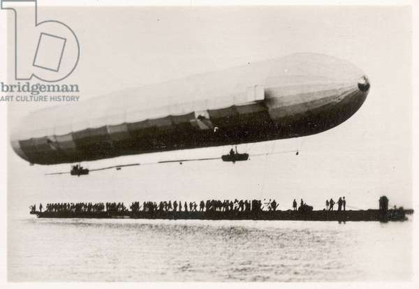 The first flight of the prototype airship Zeppelin LZ1, shown above a boat on Lake Constance, Friedrichshafen, 2nd July 1900 (b/w photo)