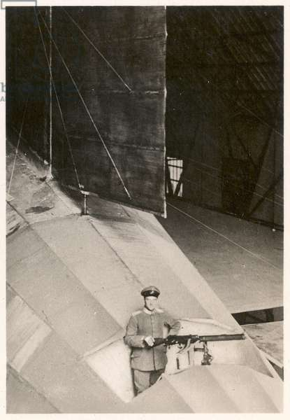 Picture No. 50: Soldier at a machine gunpost on the German military arship LZ90, from 'Zeppelin-Weltfahrten...', 1933 (silver bromide print)