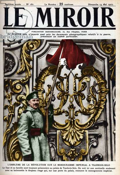 "Russian Revolution (RUSSIAN REVOLUTION, 1917.): the emblem of the revolution on the Imperial monogram in Tsarkoy-Selo. A watchman raising the red flag with his baionette on the door of the palace where the tsar and his family.Cover of """" The mirror"""" of May 1917."