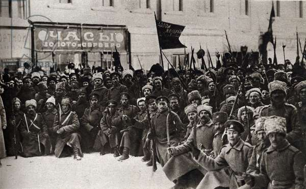 """Russian Revolution of 1917: days in Petrograd. Grenadier soldiers of the Izmailovsky regiment taking oath. On the flag we can read """"the monarchy, long live the democratic republic""""""""."""